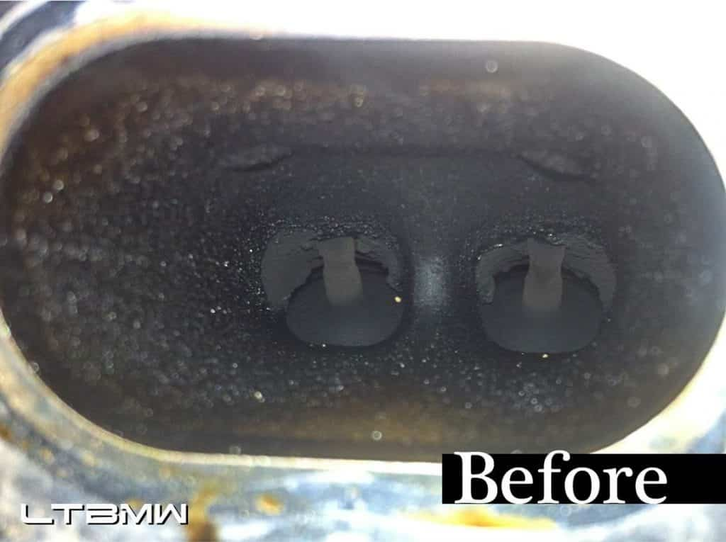 Carbon build up on an intake manifold of a direct injection engine.